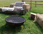 Hay bales and campfires await you
